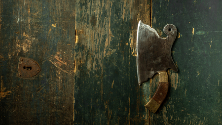 Vintage Meat cleaver on dark wooden background with copy space. Food concept recipe menu.