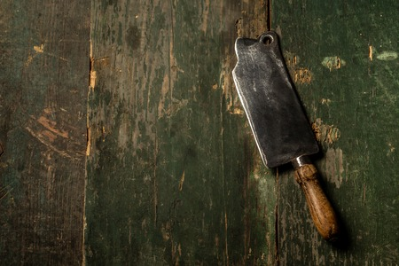 Meat Butcher Cleaver on dark wooden background with copy space. Food concept recipe menu.