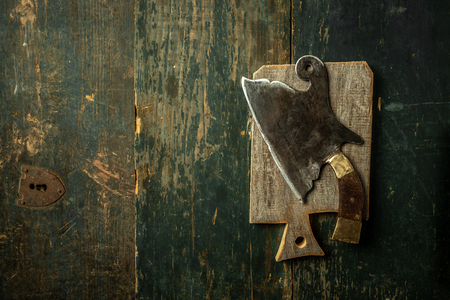 Vintage kitchenware kitchen utensils Meat Butcher Cleaver on wooden background. copy space.