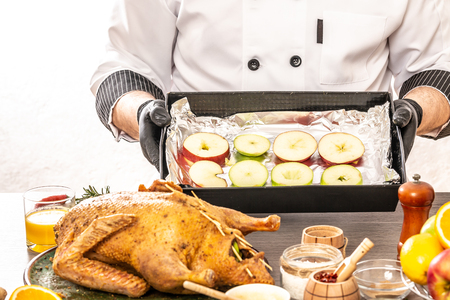 Chef cookingbaked duck in Peking. Close up on kitchen table white background. Reklamní fotografie