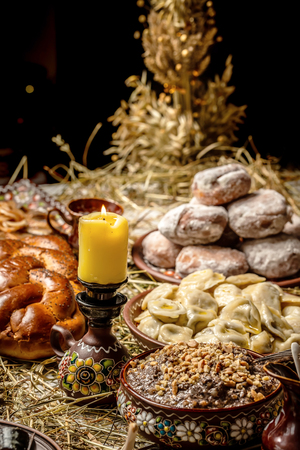 Bowl with kutia - traditional Christmas sweet meal in Ukraine, Belarus and Poland, on wooden table, Christmas Family Dinner Table Concept Reklamní fotografie