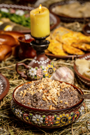 Bowl with kutia - traditional Christmas sweet meal in Ukraine, Belarus and Poland, on wooden table, Christmas Family Dinner Table Concep