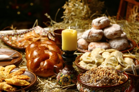 Bowl with kutia - traditional Christmas sweet meal on wooden table, Christmas Family Dinner Table Concept..