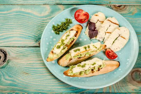 bruschetta with grilled cheese halumi on a wooden background. Preparation of cheese Halumi. Cheese Halumi with mint.