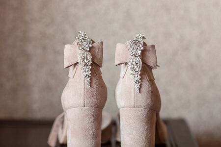 shoes and earrings for the bride. Jeweled Satin Dress Shoes Sandals. wedding concept.