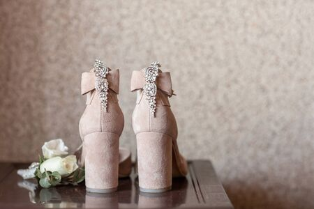 Woman shoes on the bridal veil. Wedding details.