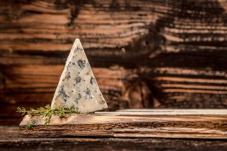 Blue cheese on the old wooden background. free space for text 写真素材