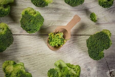 Fresh raw broccoli with copy space on grey background - summer healthy concept.