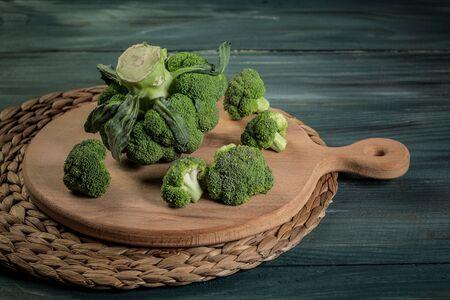 Fresh raw organic broccoli on wooden rustic background. Organic food. Reklamní fotografie