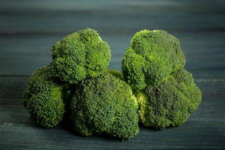 Fresh broccoli cabbage closeup view. old wooden background. Organic food. Reklamní fotografie