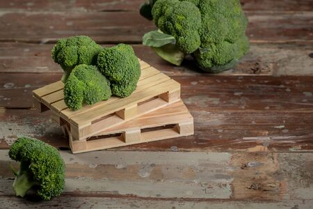 green broccoli on wood table. rustic style, old wooden background. Organic food. Reklamní fotografie