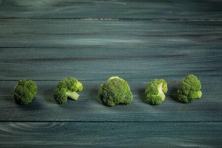 Healthy Green Organic Raw Broccoli. Steamed broccoli isolated on woden background. Reklamní fotografie