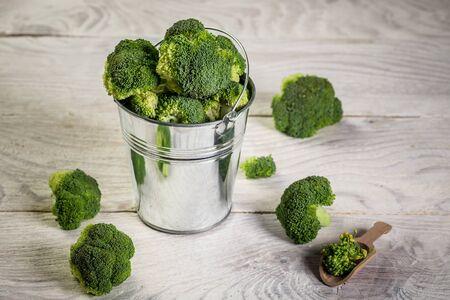 Healthy Green Organic Raw Broccoli. broccoli in a metal bucket. Reklamní fotografie