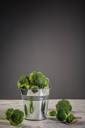 Fresh broccoli in the bowl. Healthy Green Organic Raw Broccoli. vertical image.