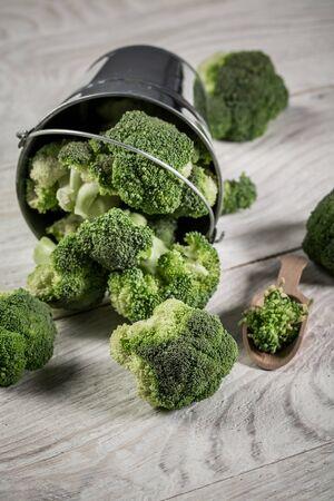 Bowl with fresh green broccoli on table. Healthy Green Organic Raw Broccoli. vertical image. Reklamní fotografie
