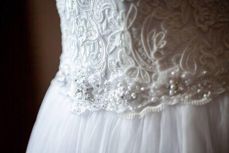 new Wedding dress detail photo. Detail of an elegant white wedding dress. Reklamní fotografie