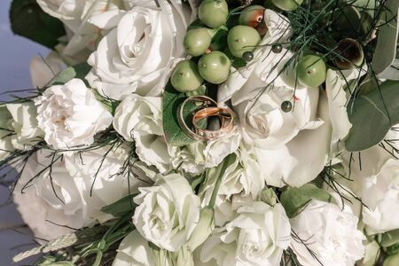 Wedding bouquet with white roses of bright colors, bouquet of bride flowers.