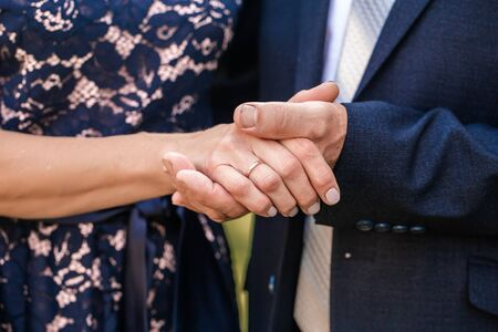 Old middle aged people holding hands close up view, family couple express care concept happy marriage, empathy hope understanding love for many years.