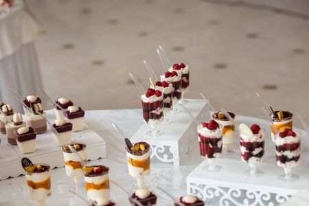 Dessert table for a party. Candy bar. Table with sweets, candies, dessert.
