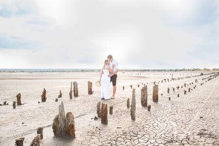 abandoned salt production. Salt lane enclosed by dried wooden pillars on a salt lake. Adventure travel lifestyle concept.
