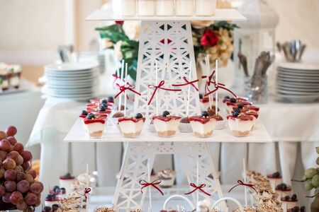 Festive table served for celebration of wedding. Candy bar. Imagens
