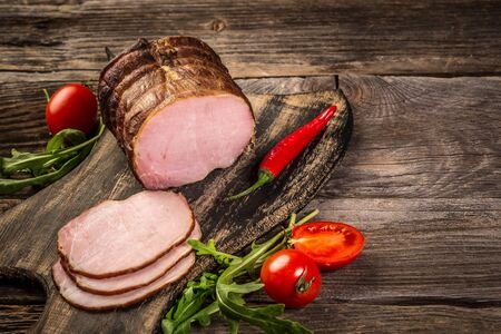 Homemade smoked ham, sliced. View from above. Traditionally smoked meats. banner menu recipe place for text. top view. Stock Photo