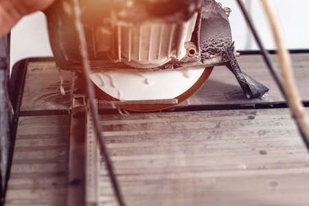 A circular saw. cut the tile. Tiled work. Facing work. electric power tool. cutting ceramic tile with water cutting machine. Stock fotó