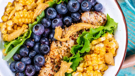 Colorful summer berry salad with corn, lemon, mustard, Food recipe background. Close up.