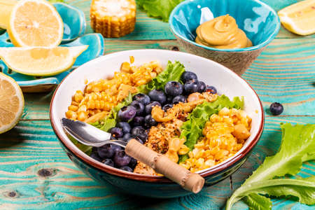 Green salad with berries and corn, healthy food concept, catering.