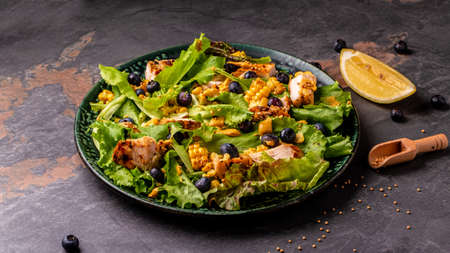 Diet menu. Healthy salad of fresh berries, chicken fillet, green vegetables and mustard. healthy food. banner, catering menu recipe place for text, top view.
