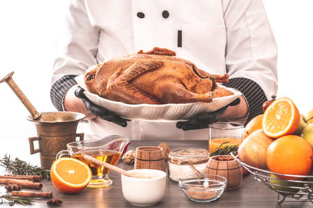 Recipe for cooking whole duck with oranges and aromatic spices, Cooking chef duck. banner, menu, recipe, place for text