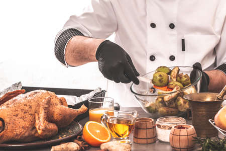 Cooking chef duck stuffed with fragrant oranges and green apples, banner, menu, recipe, place for text