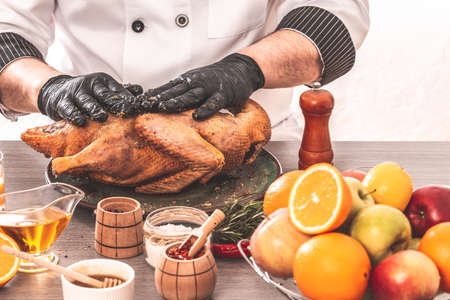 Cooking chef duck sprinkled with oranges, seasonin for the festive table, Independence Day of the United States, Day of Grace, Christmas. menu recipe place for text 写真素材