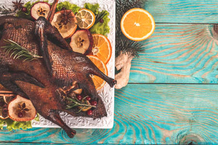 Festive Christmas duck baked with apples and citrus fruit. banner, catering menu recipe place for text, top view 写真素材