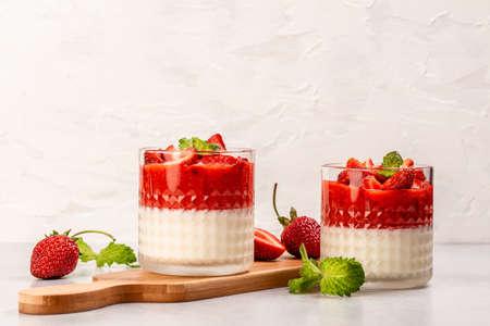 Traditional Italian dessert panna cotta with strawberry jelly. Summer yogurt dessert. catering, banner, menu, recipe, place for text 写真素材