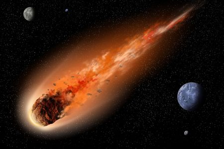 Asteroid with tail of fire flying between planets in space photo