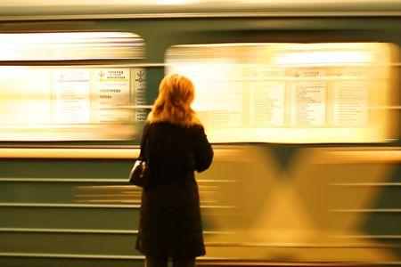 tardiness: woman and subway train