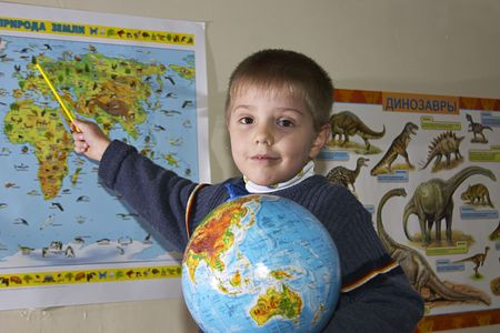 boy with globe in front of map Stock Photo - 291751