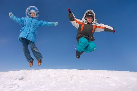 boy and girl jumping in the sky photo