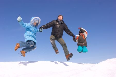 Father son and daughter jumping photo