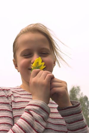 spring windy photo of young girl with yellow snowdrop Stock Photo - 611940