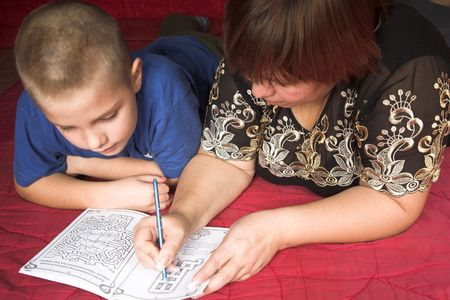 mother with son reading book on the red Stock Photo - 3498588
