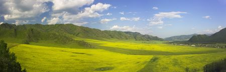 panorama with agricultural field, mountains and cloudy sky  Stock Photo - 3512017