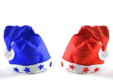 red and blue holiday hats isolated on white with  copy space photo