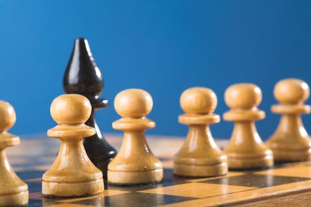 battling: row of pawns and one bishop. Chess on the chessboard