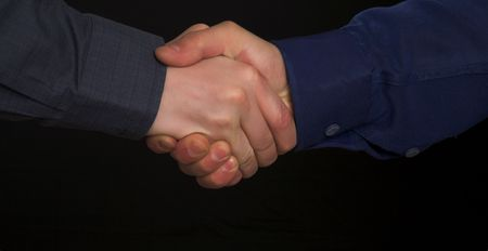 handclasp: handclasp. two mens hands isolated on black background