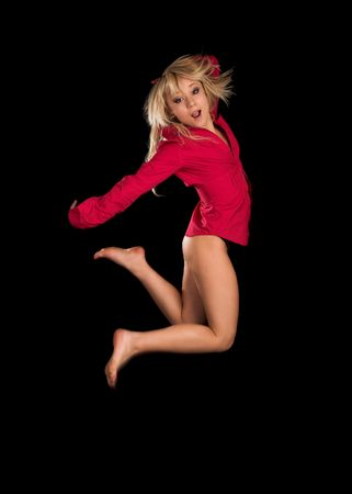 Jumping sexy girl on black isolated background photo