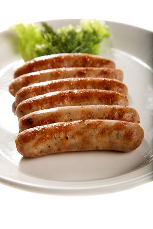 grilled sausage with lettuce isolated on white