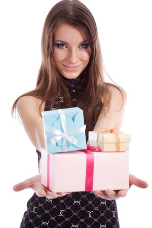 extending: Young beautiful girl extending festive boxes smiling Stock Photo