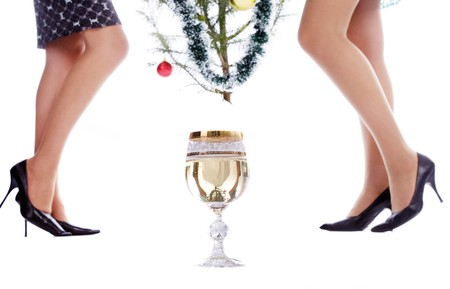 Glasses of champagne with girls legs reflection photo
